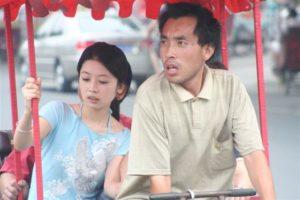 Due cinesi sulla bicicletta
